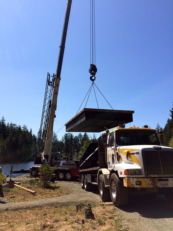 One of two new docks is lifted into place on Poirier Lake (click on photo for larger image)