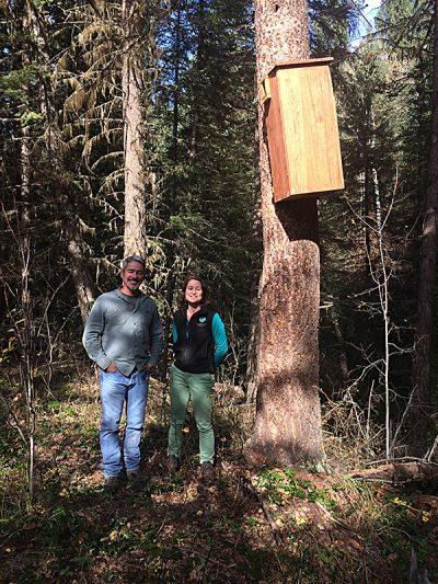 HCTF biologist Kathryn Martell and Larry Davis pose for a photo after putting the ladder away.