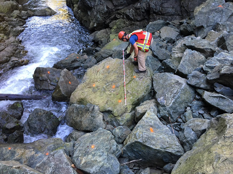 An engineer marks drilling locations in preparation for Wednesday's rock breaking on the Seymour River.